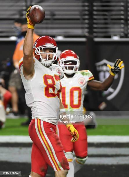 Tight end Travis Kelce and wide receiver Tyreek Hill of the Kansas City Chiefs celebrate after Kelce caught a game-winning 22-yard touchdown pass...