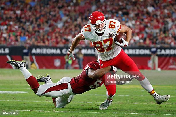 Tight end Travis Kelce of the Kansas City Chiefs avoids a tackle from inside linebacker Kenny Demens of the Arizona Cardinals during the first...