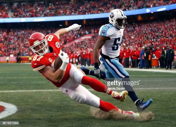 Tight end Travis Kelce of the Kansas City Chiefs catches a pass in the endzone for a touchdown as inside linebacker Avery Williamson of the Tennessee...
