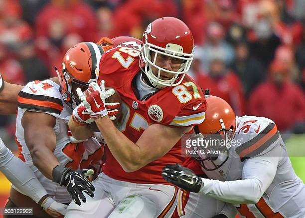 Tight end Travis Kelce of the Kansas City Chiefs catches a pass against defenders Nate Orchard and Donte Whitner of the Cleveland Browns during the...