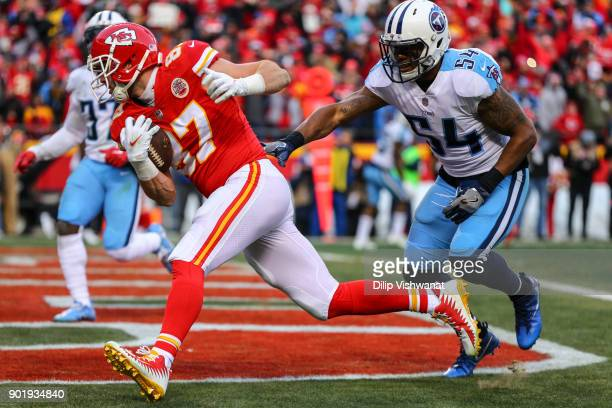 Tight end Travis Kelce of the Kansas City Chiefs catches the games first touchdown pass behind inside linebacker Avery Williamson of the Tennessee...