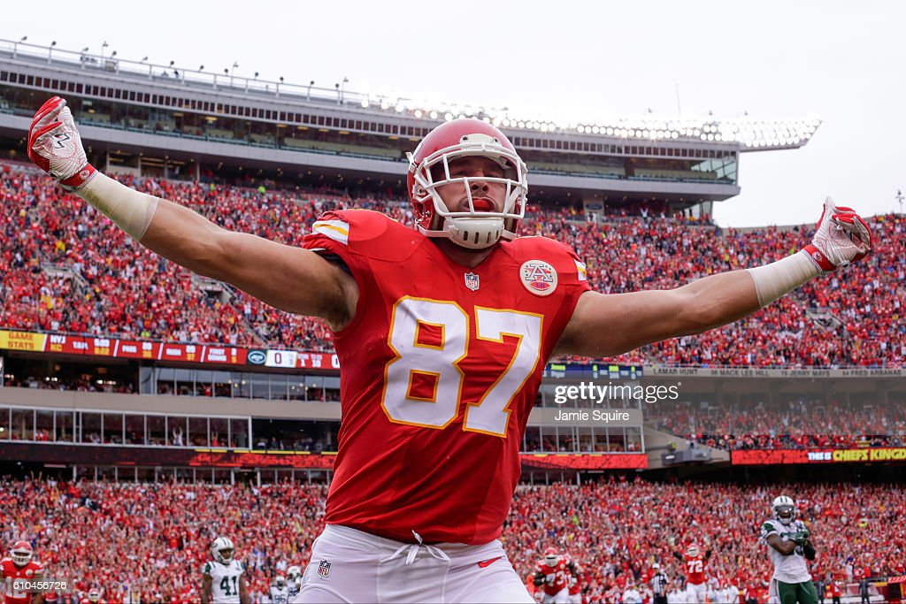 Tight end Travis Kelce #87 of the Kansas City Chiefs celebrates in the end zone after scoring the games first touchdown agains the New York Jets at Arrowhead Stadium during the first quarter of the game on September 25, 2016 in Kansas City, Missouri.
