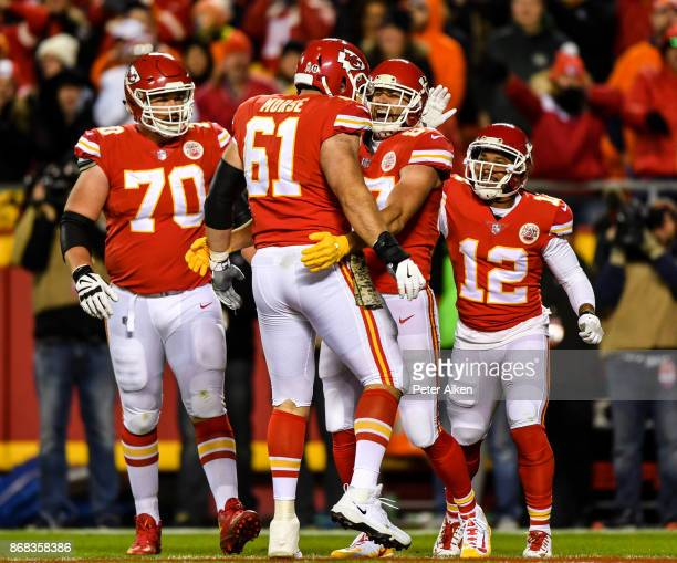 Tight end Travis Kelce of the Kansas City Chiefs celebrates with teammate Mitch Morse after a touchdown catch against the Denver Broncos during the...