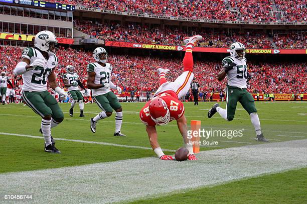 Tight end Travis Kelce of the Kansas City Chiefs dives in to the end zone to score the games first touchdown in front of cornerback Marcus Williams...