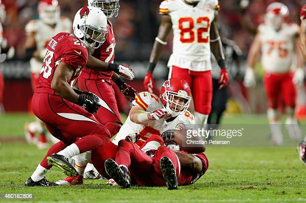 Tight end Travis Kelce of the Kansas City Chiefs fumbles the ball after being hit by strong safety Deone Bucannon of the Arizona Cardinals in the...