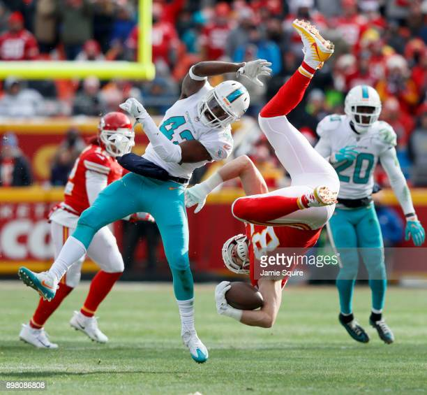Tight end Travis Kelce of the Kansas City Chiefs gets flipped upside down after leaving his feet on a tackle by defensive back Alterraun Verner of...