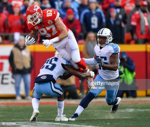 Tight end Travis Kelce of the Kansas City Chiefs goes up in the air while being tackled by cornerback Adoree' Jackson of the Tennessee Titans during...