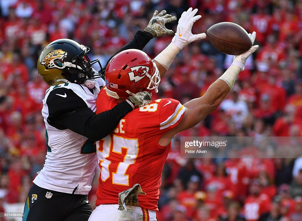 Tight end Travis Kelce #87 of the Kansas City Chiefs goes up to catch a pass in the end zone covered by cornerback Prince Amukamara #21 of the Jacksonville Jaguarsat Arrowhead Stadium during the fourth quarter of the game on November 6, 2016 in Kansas City, Missouri.