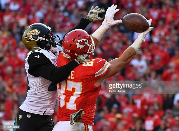 Tight end Travis Kelce of the Kansas City Chiefs goes up to catch a pass in the end zone covered by cornerback Prince Amukamara of the Jacksonville...
