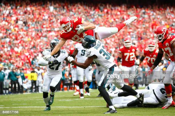 Tight end Travis Kelce of the Kansas City Chiefs leaps into the end zone over Philadelphia Eagles tacklers in the fourth quarter of the game between...
