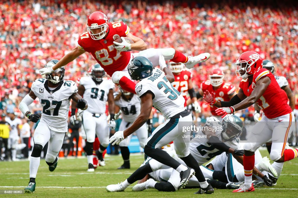 Tight end Travis Kelce #87 of the Kansas City Chiefs leaps into the end zone over Rasul Douglas #32 of the Philadelphia Eagles in the fourth quarter of the game between the at Arrowhead Stadium on September 17, 2017 in Kansas City, Missouri.