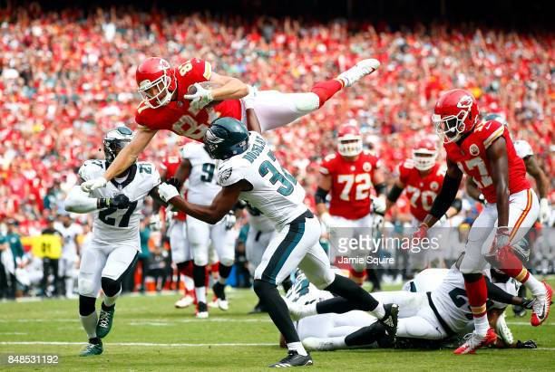 Tight end Travis Kelce of the Kansas City Chiefs leaps over defenders into the end zone for a touchdown during the 2nd half of the game against the...