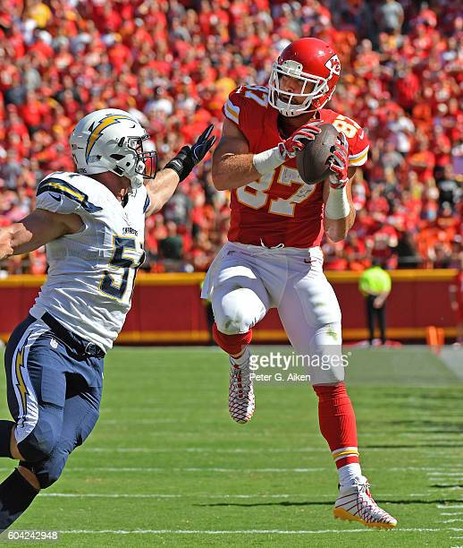 Tight end Travis Kelce of the Kansas City Chiefs makes a catch against linebacker Kyle Emanuel of the San Diego Chargers during overtime half on...