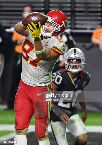 Tight end Travis Kelce of the Kansas City Chiefs makes a game-winning touchdown reception in the end zone past the defense of cornerback Damon...