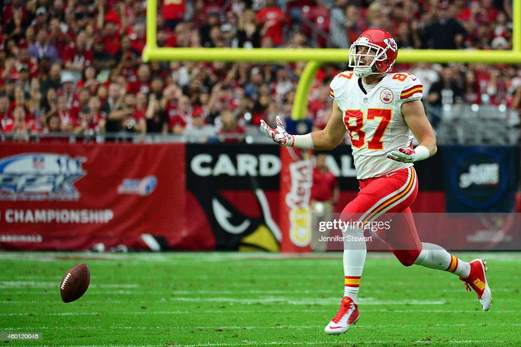 Tight end Travis Kelce #87 of the Kansas City Chiefs misses a pass in the first half of the NFL game against the Arizona Cardinals at University of Phoenix Stadium on December 7, 2014 in Glendale, Arizona.