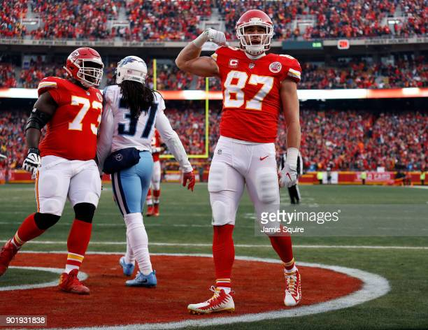 Tight end Travis Kelce of the Kansas City Chiefs reacts after catching a pass in the endzone for a touchdown during the 1st quarter of the AFC Wild...