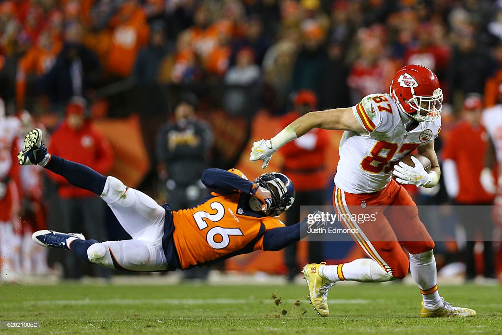 Tight end Travis Kelce #87 of the Kansas City Chiefs shakes off free safety Darian Stewart #26 of the Denver Broncos after catching a pass in overtime at Sports Authority Field at Mile High on November 27, 2016 in Denver, Colorado.
