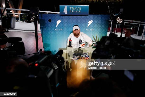 Tight end Travis Kelce of the Kansas City Chiefs speaks to the media during Super Bowl Opening Night presented by BOLT24 at Marlins Park on January...