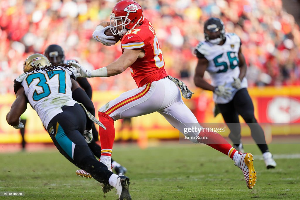 Tight end Travis Kelce #87 of the Kansas City Chiefs stiff arms strong safety Johnathan Cyprien #37 of the Jacksonville Jaguars at Arrowhead Stadium during the fourth quarter of the game on November 6, 2016 in Kansas City, Missouri.