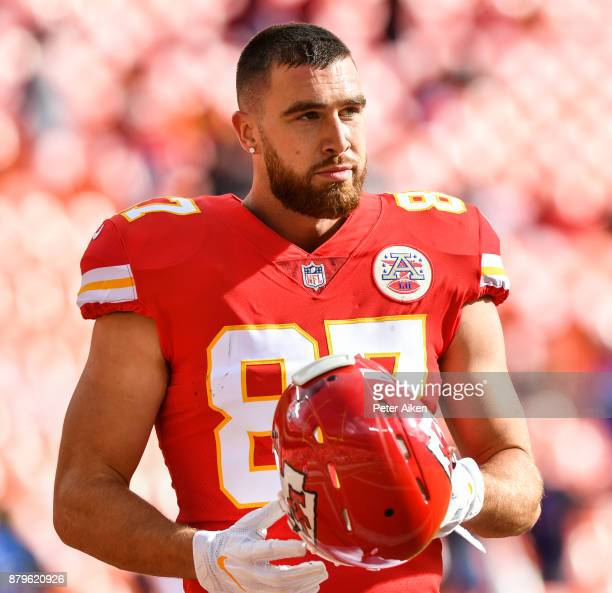 Tight end Travis Kelce of the Kansas City Chiefs walks with his helmet off prior to the game against the Buffalo Bills at Arrowhead Stadium on...