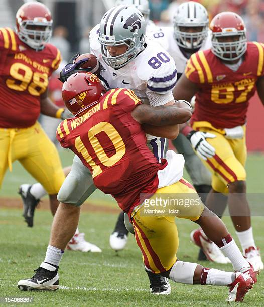 Tight end Travis Tannahill of the Kansas State Wildcats is tackled during the third quarter by defensive back Jacques Washington of the Iowa State...
