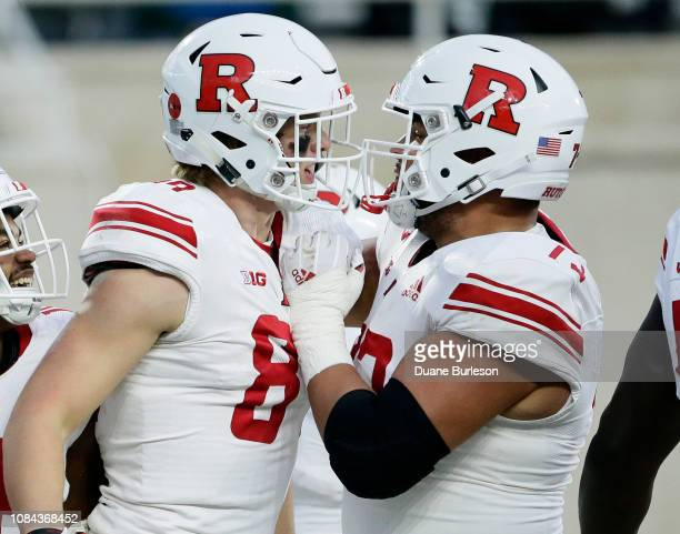 Tight end Travis Vokolek of the Rutgers Scarlet Knights celebrates with offensive lineman Jonah Jackson of the Rutgers Scarlet Knights after scoring...