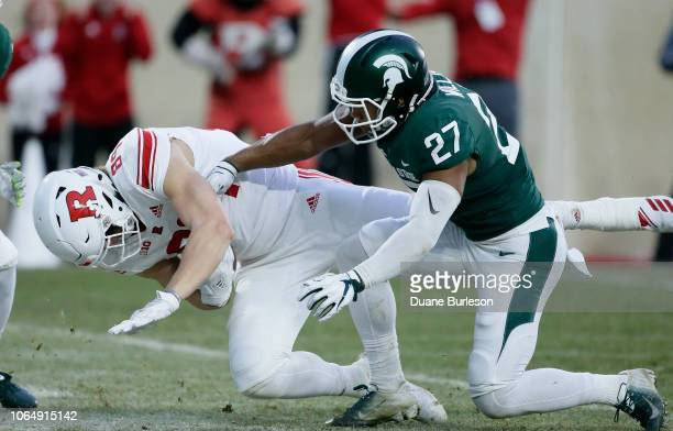 Tight end Travis Vokolek of the Rutgers Scarlet Knights scores past safety Khari Willis of the Michigan State Spartans on a pass play during the...