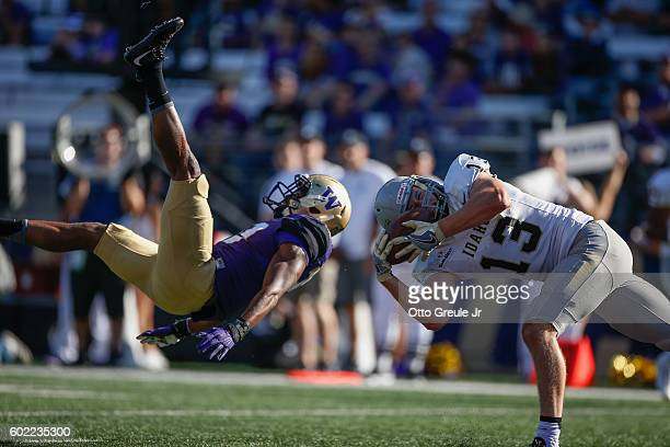 Tight end Trent Cowan of the Idaho Vandals makes a catch for a touchdown against defensive back Trevor Walker of the Washington Huskies on September...