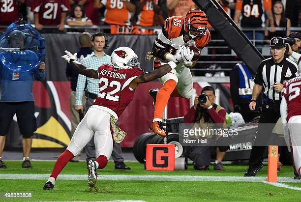 Tight end Tyler Eifert of the Cincinnati Bengals hauls in a first quarter touchdown pass over safety Tony Jefferson of the Arizona Cardinals during...