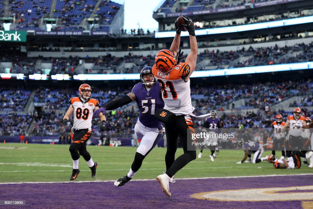 Tight End Tyler Kroft #81 of the Cincinnati Bengals catches a touchdown in the first quarter against Kamalei Correa #51 of the Baltimore Ravens at M&T Bank Stadium on December 31, 2017 in Baltimore, Maryland.