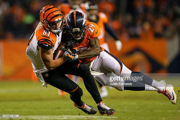 Tight end Tyler Kroft of the Cincinnati Bengals is tackled by free safety Bradley Roby of the Denver Broncos after a 12 yard reception in the second...