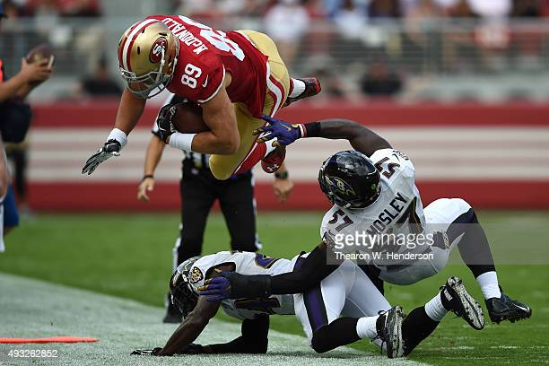 Tight end Vance McDonald of the San Francisco 49ers is hit by inside linebacker CJ Mosley of the Baltimore Ravens after a 10yard catch during their...