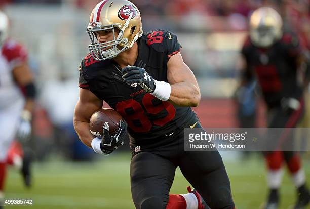 Tight end Vance McDonald of the San Francisco 49ers runs into the endzone for a touchdown against the Arizona Cardinals during an NFL football game...