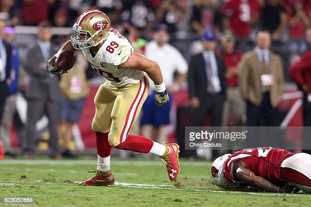 Tight end Vance McDonald of the San Francisco 49ers runs past outside linebacker Deone Bucannon of the Arizona Cardinals during the fourth quarter of...