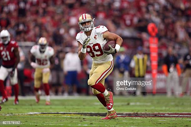 Tight end Vance McDonald of the San Francisco 49ers runs up field during the first half of the NFL football game against the Arizona Cardinals at...