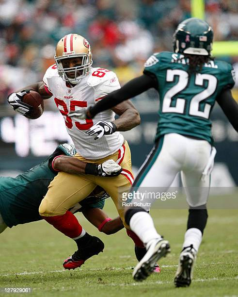 Tight end Vernon Davis of the San Francisco 49ers is wrapped up by safety Jarrad Page of the Philadelphia Eagles cornerback Asante Samuel closes in...