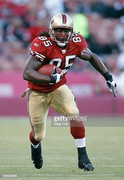 Tight end Vernon Davis of the San Francisco 49ers looks for room during a preseason game against the Oakland Raiders on August 18 2007 at Monster...