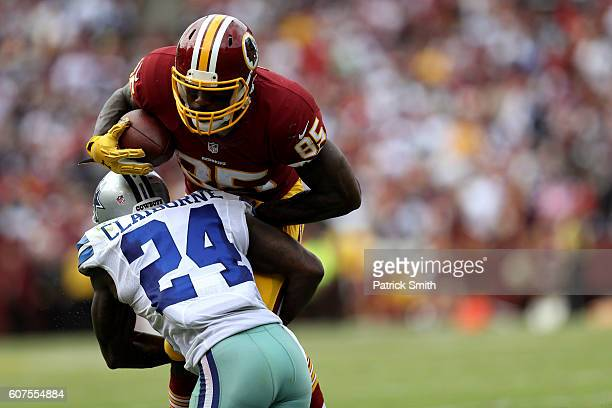 Tight end Vernon Davis of the Washington Redskins carries the ball against cornerback Morris Claiborne of the Dallas Cowboys in the third quarter at...