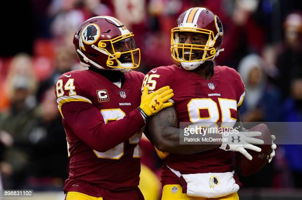 Tight end Vernon Davis of the Washington Redskins celebrates with tight end Niles Paul after scoring a touchdown against the Denver Broncos in the...