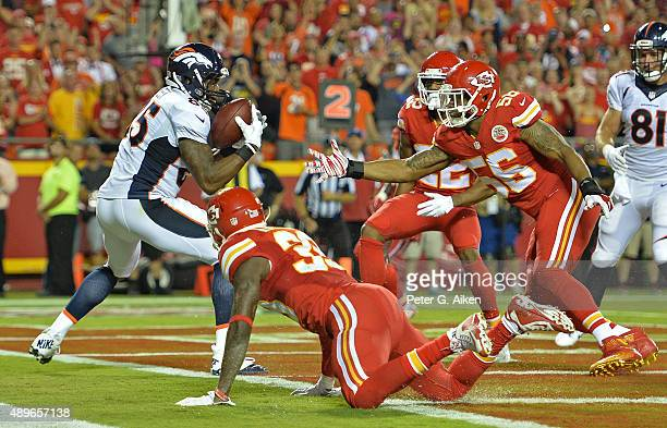 Tight end Virgil Green of the Denver Broncos catches a touchdown pass against linebacker Derrick Johnson of the Kansas City Chiefs during the first...