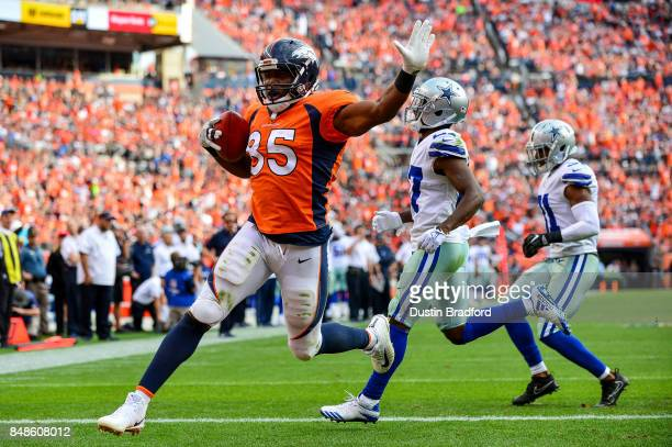 Tight end Virgil Green of the Denver Broncos runs into the end zone with a third quarter touchdown against the Dallas Cowboys at Sports Authority...