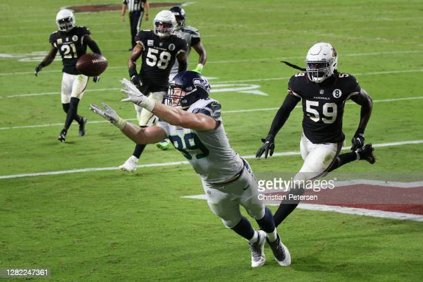 Tight end Will Dissly of the Seattle Seahawks is unable to catch a pass ahead of outside linebacker De'Vondre Campbell of the Arizona Cardinals...