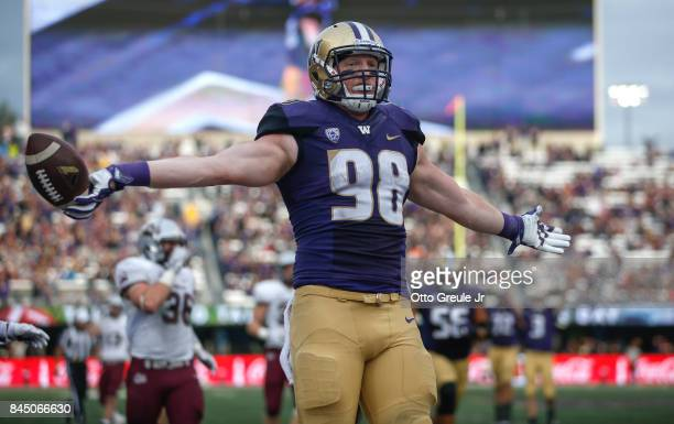 Tight end Will Dissly of the Washington Huskies reacts after scoring a touchdown in the second quarter against the Montana Grizzlies at Husky Stadium...