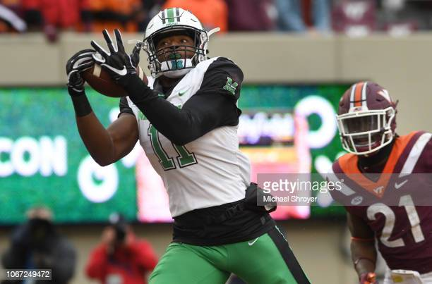 Tight end Xavier Gaines of the Marshall Thundering Herd scores a touchdown against the Virginia Tech Hokies in the second half at Lane Stadium on...