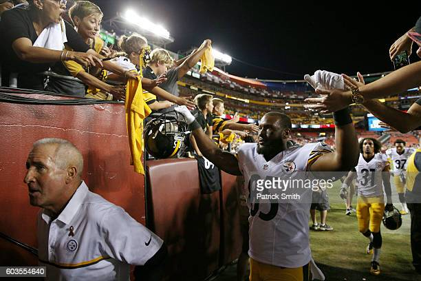 Tight end Xavier Grimble of the Pittsburgh Steelers celebrates with fans after the Pittsburgh Steelers defeated the Washington Redskins 38-16 at...