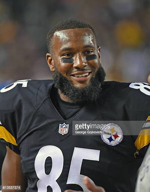 Tight end Xavier Grimble of the Pittsburgh Steelers smiles as he looks on from the sideline during a game against the Kansas City Chiefs at Heinz...