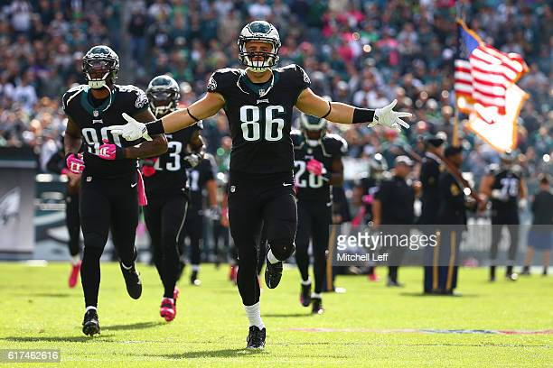 Tight end Zach Ertz and defensive end Marcus Smith both of the Philadelphia Eagles take to the field at Lincoln Financial Field against the Minnesota...