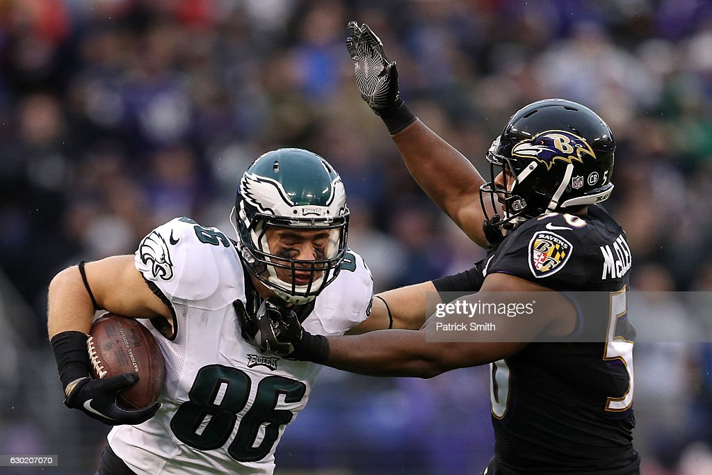 Tight end Zach Ertz #86 of the Philadelphia Eagles carries the ball against outside linebacker Albert McClellan #50 of the Baltimore Ravens in the second quarter at M&T Bank Stadium on December 18, 2016 in Baltimore, Maryland.