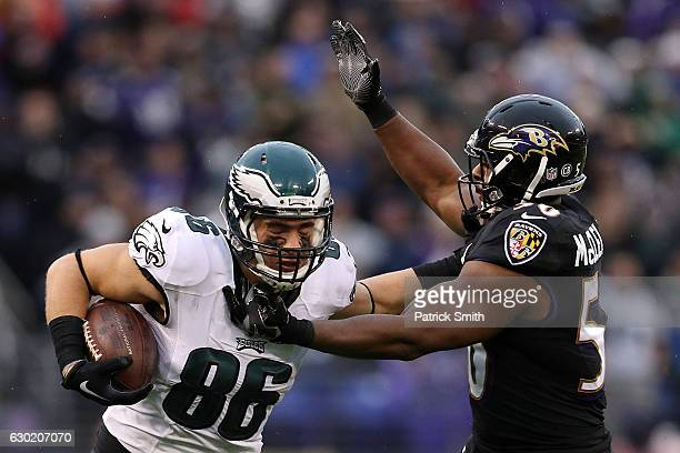 Tight end Zach Ertz of the Philadelphia Eagles carries the ball against outside linebacker Albert McClellan of the Baltimore Ravens in the second...