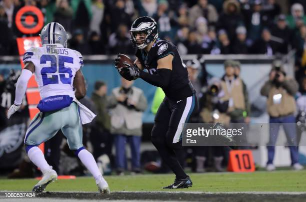 Tight end Zach Ertz of the Philadelphia Eagles carries the ball to score a touchdown against the Dallas Cowboys in the third quarter during the third...